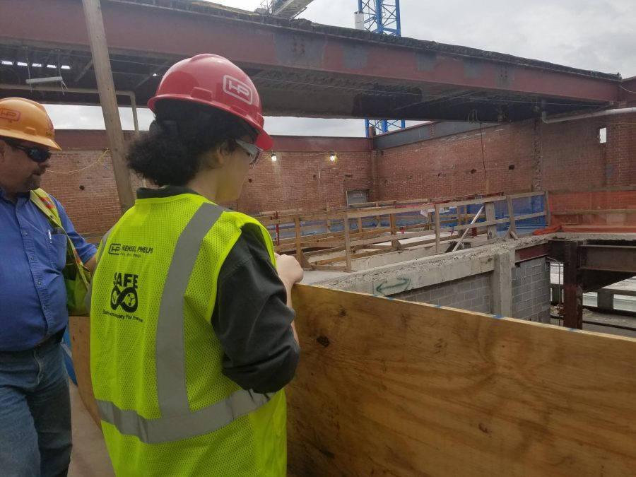 Dave Webb shows Occupational Safety Student Ryan Vaughn the elevator shaft where steel I-beams were lowered by crane.
