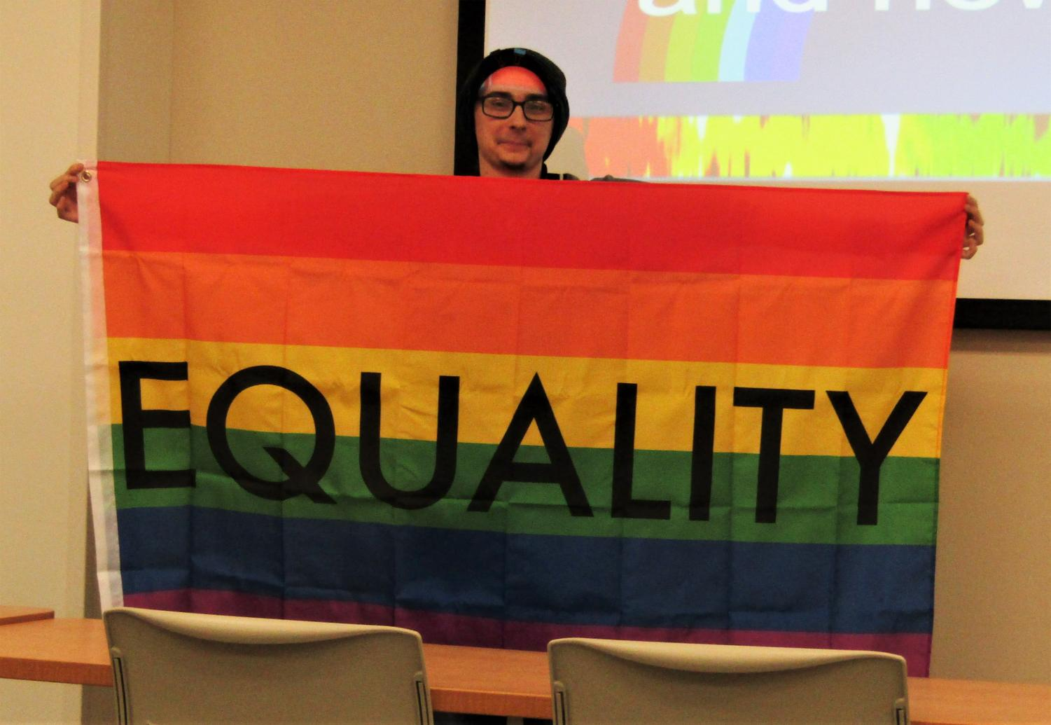 Falcons w/PRIDE is gifted a flag by a panel members Shay Hess and Zettie Bowling (Lars Lehman in photo)